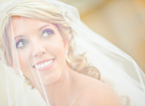 Blonde Bride Behind Her Veil