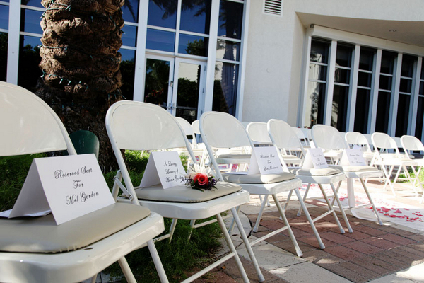 Outdoor Ceremony White Chairs & Signs