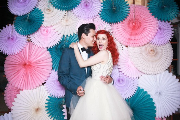 paper wheels photo backrop Gorgeous Photo Booth Ideas For Your Wedding Reception