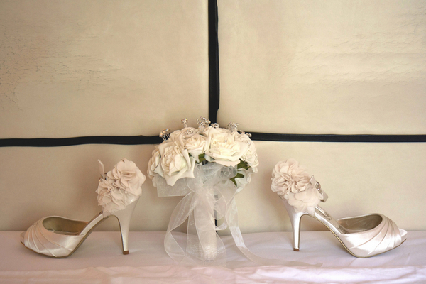 bridal shoes ivory flowers Lake Garda Wedding at Malcesine Castle by Belle Momenti Photography