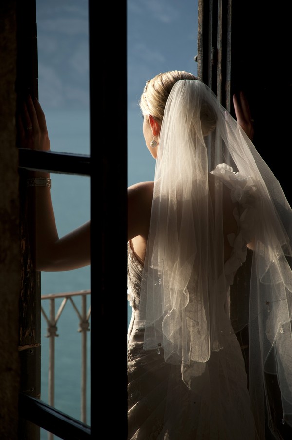 bride overlooking lake garda italy Lake Garda Wedding at Malcesine Castle by Belle Momenti Photography